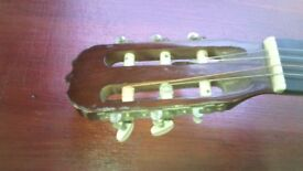 adult guitar, 39 x 14 inch