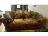 Three seater sofa with feather cushions