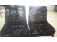 A pair of comfortable chairs suitable for both living room or outdoor