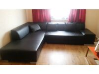 "BLACK LEATHER ""L"" SHAPE SOFA WITH THREE CUSHIONS £140"
