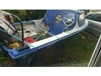 small fishing boat with outboard