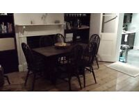 Dark wood dining table and six chairs