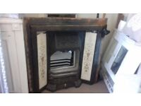 CAST-IRON tiled fireplace.
