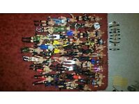 50 wrestling figures plus accessories, belts and ring