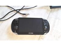 PS VITA with Charger good condition factory reset and good to go with one game.