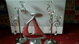 Silver candle stick holders and boat