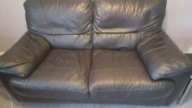 2 x 2 seater black leather sofas
