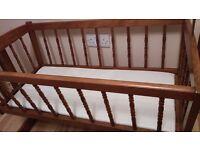 Swinging crib and mattress