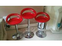 3 retro red and stainless telescopic bars stools..decent condition