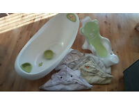 Like new - baby bath with stand, bath support and hooded towels