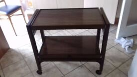 Brown, polished finished, trolley with very easy to use knob to alter from 2 shelves to a full table