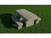 Smooth stone table and bench