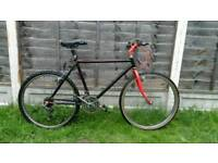 Mens black and red mountain bike