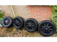"""VW Golf. Set of 15"""" black alloy wheels fitted with very good tyres £125."""