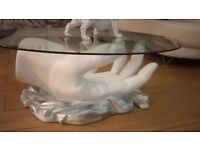 Hand glass coffee table