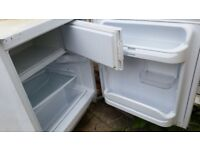 Integrated Indesit white under counter fridge with freezer compartment
