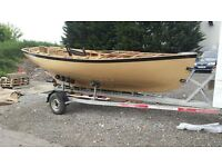 boat project good trailer and like new 4hp outboard
