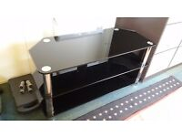 smokes glass and chrome TV stand