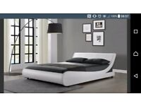 King size white faux leather bed