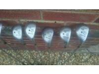 7 assorted golf clubs