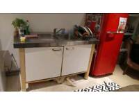 Kitchen units with oven, hob, sink and stainless steel tops