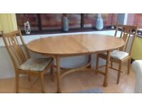 Ercol dining suite. Excellent condition. Extending table with 6 chairs with removable cushions.