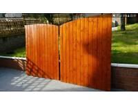 Scandinavian redwood driveway gates