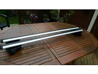 Thule roof rack for roof rails.