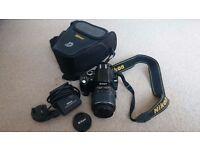 Nikon D60 D-SLR camera, 18-55 lens, with 2GB memory card and camera bag