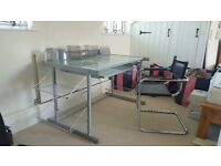 Desk in glass and steel with leather chair.