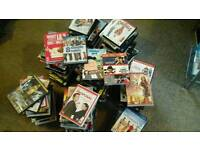 OVER 150 ASSORTED DVDS