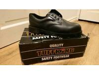 Tuffking steel toe cap safety shoes.