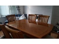 Solid Oak 6 setting Table and chairs. Excellent condition £200