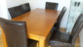 Medium Oak Dining table and chairs