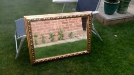 Gold coloured framed mirror 33x 24""