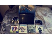 Sony PS3 Slimline + 2 Controllers, 4 Games.