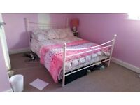 Selling my white cream metal double bed without mattress in excellent condition year old