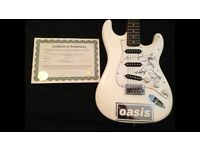 Signed Oasis fender strat with authentication certificate