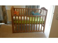Mothercare baby cot with heigh adjustable / removable side panel and mattress both in good condition