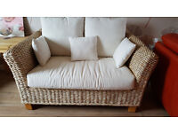 2 Wicker sofas with cushions.