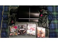 Play Station 3 with 4 games and 2 controllers.