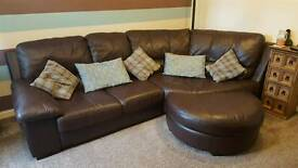 Large brown leather corner sofa and chair with footstool