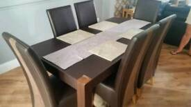 Leather dining table with 6 chairs