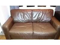 Brown leather sofabed