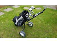 A full set of golf clubs, bag and trolley