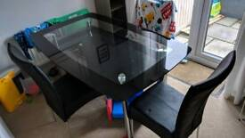Metal and glass boat dining table and chairs