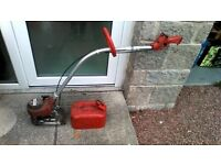 Homelite ST80 2 stroke petrol strimmer and petrol can
