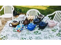 Eleven collectable teapots