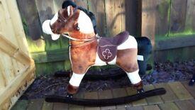 Boy toddler rocking horse