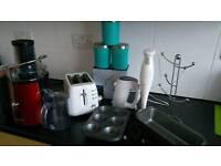 Juice maker, toaster, hand mixer, blender, baking trays, cups hanger and extra - car navigation